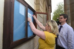 The notice of the Recall Petition being pinned outside the Town Hall