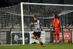 Jordon Crawford heads off to celebrate after he put Corby Town 2-0 up in their play-off semi-final success over Bedford Town. Pictures by Alison Bagley