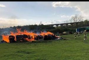 The hay bales being extinguished by Northants Fire and Rescue crews. There is an appeal for witnesses. Picture courtesy of Ollie Toseland.