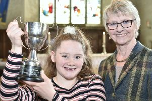 Drama Festival overall winner Daisy Reeves-Turner with her trophy presented by Festival Chairman   Pam Tedcastle. EMN-190605-094304009
