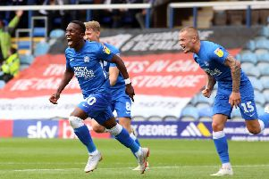 Sirki Dembele celebrates his goal for Posh against Luton last season.