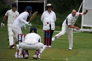 Brackley's Keith Cartwright sends a delivery to Great & Little Tew's Alup Maqbool. Photo: Jake McNulty