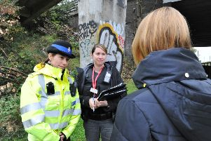 Police officers putting out notices and talking to passers-by on a walkway between Rhubarb Bridge at North Bretton -  the scene of a recent assault EMN-170710-200908009