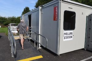 A polling station in the car park at House of Feasts in Eye
