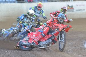 Heat one action from Panthers win over Poole with Bradley Wilson-Dean (blue helmet) and Hans Andersen in action for the city side. Photo: David Lowndes.