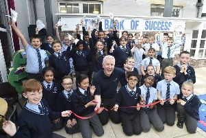 Pupils at the Discovery primary school at the opening of the school bank with sponsor Peter Melkowski of Print Solutions EMN-190520-222245009