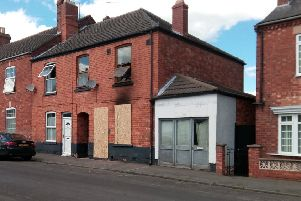 Boarded up. Tim Sampson's fire damaged home in Queen Street, Sleaford. EMN-190524-175313001