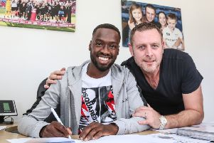 Posh chairman Darragh MacAnthony (right) with record signing Mo Eisa.