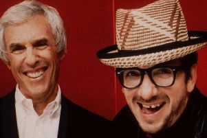 "Burt Bacharach, left, and Elvis Costello pose in this 1998 promotional photo for their collaborative album, ""Painted from memory."""