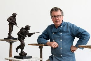 David Williams-Ellis with two of the maquettes used as he designed the D-day statue. Photo: Ken Adlard