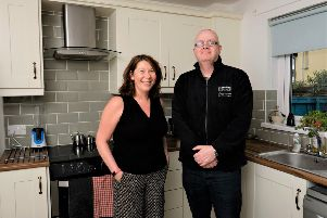 Tenant Joanne McAuley with Neighbourhood Officer, Thomas McDaid in her new kitchen.