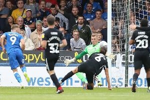 Matt Godden (9) scores for Posh against Portsmouth last season. Photo: Joe Pepler.