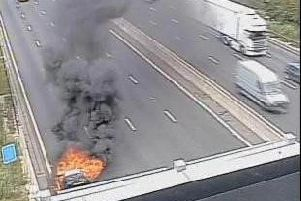 Highways released this CCTV image showing the car fire on the M1