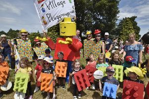 Werrington Carnival -   The Village playgroup with its giant Legoman EMN-180623-161934009