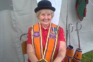 Marion with the band during a Twelfth of July parade