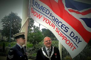 The flag-raising ceremony for Armed Forces Day outside the Melton Borough Council offices - Mayor of Melton, Councillor Malise Graham, with Sgt Melvin Whyte, who hoisted the flag EMN-190624-155426001