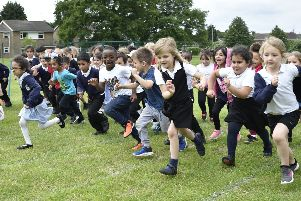 Longthorpe Primary School reception children starting a series of charity races at the school EMN-190618-223947009