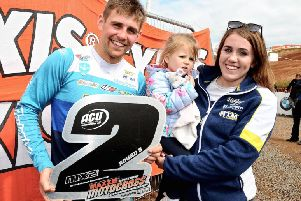 Glenn McCormick pictured with his sister Chloe and daughter Lacey after picking up his trophy for second place in the Experts MX2 class.