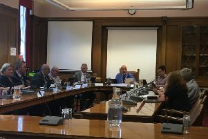 The committee discussing the report