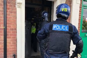 Police carrying out a raid in London Road. Photo: Cambridgeshire police