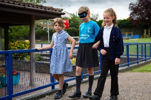 Charlotte (9) wears blind fold for the day in aid of Guide Dogs for the Blind.,'Folksworth Primary School, Peterborough'08/07/2019. 'Picture by Terry Harris / Peterborough Telegraph. THA
