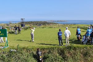 Tiger Woods, Dustin Johnson and Rickie Fowler take part in a practice session.