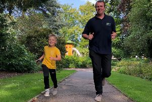 Rob Peet and son Christopher (5) run one of their golden miles for LOROS EMN-190715-153037001