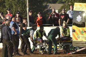 Josh Bates is taken away by paramedics after his nasty crash at the East of England Arena. Photo: David Lowndes.