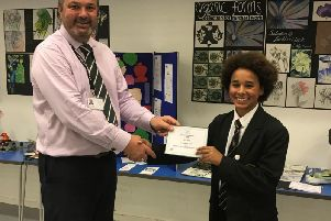 Buckingham School headteacher Andy McGinnes presents a certificate to Seth Mmanga for his efforts in the UK Mathematics Trust's junior challenge