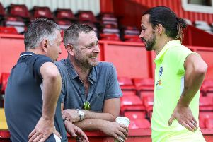 George Boyd with Posh chairman Daragh MacAnthony (centre) and Darren Ferguson (left). Photo Joe Dent/theposh.com.