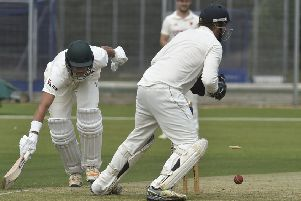 Peterborough Town's David Sayer just avoided being run out against Oundle here. Dan Robinson is the Oundle wicket-keeper. Photo: David Lowndes.