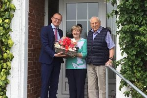 Reg and Eleanor Rendell of Cable Road in Whitehead are congratulated by Neil McCracken, general manager, Sales at Phoenix Natural Gas, on being the town's first customer to connect to the natural gas network as part of a major expansion project.