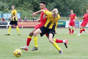 Lochlan Colqultown, seen here up against Banbury United's Amer Awadh, is one of the younger additions at Easington Sports
