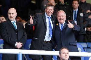 Posh co-owner Dr Jason Neale (centre) with director of football Barry Fry (right).