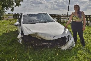 Georgina Bolster looking at the Mercedes which left the road at New Cut, Thorney and entered the front garden of the family home f EMN-190508-201140009