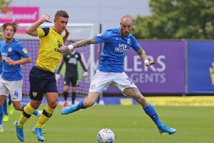 Marcus Maddison (Posh) and Cameron Brannagan (Oxford) in action. Photo: Joe Dent/theposh.com.