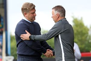 Rival managers Darren Ferguson (right) and Karl Robinson shake hands before the Posh game at Oxford. Photo: Joe Dent/theposh.com.