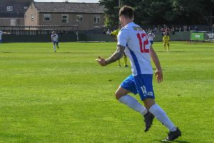 Sam Johnson heads off to celebrate after he scored AFC Rushden & Diamonds' second goal in their 2-0 win over Nuneaton Borough. Picture courtesy of HawkinsImages