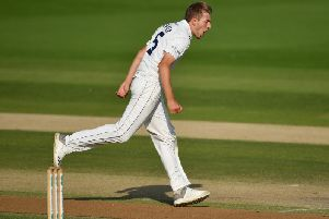 Jared Warner celebrates snaring Nick Gubbins as Sussex get on top v Middlesex / Picture: Getty Images