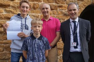 Top scoreer Toby Barnett achieved ten 9 grades, an 8 and an A* for Further Maths. He is pictured with his dad James, younger brother Noah and headmaster Alistair Hopkins EMN-190822-125053001