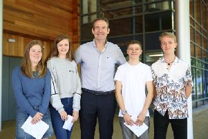 Headmaster John Green celebrating results with Tabitha Hill, Nia Burkinshaw, Harry Thompson and Sam French. Photo: Seaford College