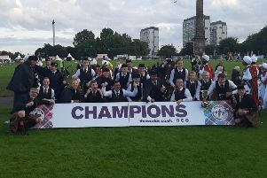 Tullylagan Pipe Band, who picked up the Ulster Grade 3B title on Saturday, celebrate their world title success at Glasgow last weekend