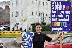 Rev Andrew Rawding, Church of Ireland rector for Coalisland & Stewartstown, travelled to Derry to support the Foyle Pride parade, which was met with a protest from by religious group at the Duke Street Roundabout. DER3519-113KM