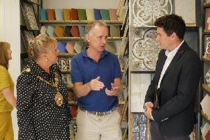 Cllr Kathy Harmer, Mark O'Sullivan and Huw Merriman MP at the shop's official opening