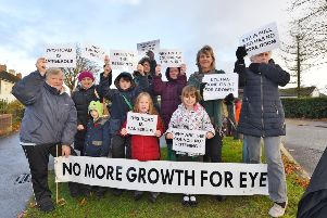 Protests outside Eye C of E Primary School after nearby land was allocated for 250 new homes