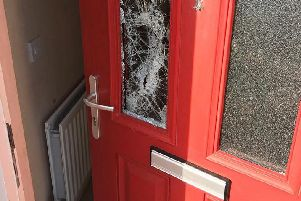 One of the doors damaged during the searches.