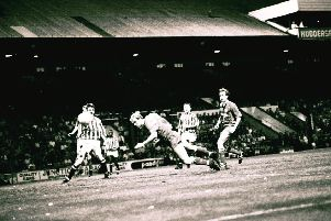 Steve Cooper scores for Posh at Huddersfield in a 1992 play-off match.