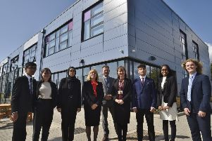 Jack Hunt School headteachers  Pamela Kilbey and Kate Simpson with business manager Matthew Deere and sixth form prefects outside the school's new extension. EMN-190409-211015009