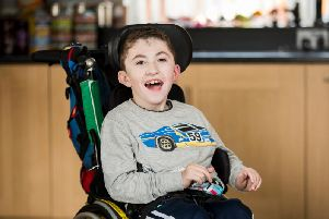 Jack McCrystal who has a neuro-muscular disorder which means he is fed through a tube and uses a wheelchair, at home in Draperstown in Co Londonderry.