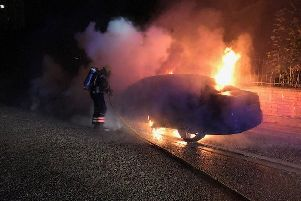 The car fire being tackled in Westmoreland Gardens. Photo: Cambridgeshire Fire and Rescue Service
